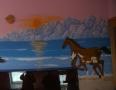 Konie na tle wschodzącego słońca